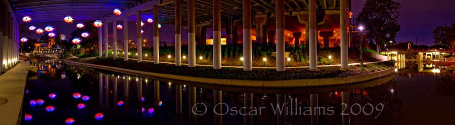 Under the IH 35 bridge at night with the Sunfish by Donald Lipiski illuminated.